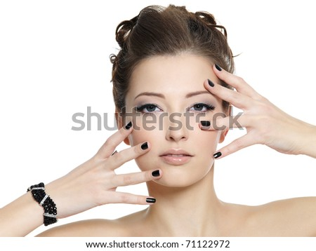 Beautiful glamour young woman with black manicure  posing on white background - stock photo