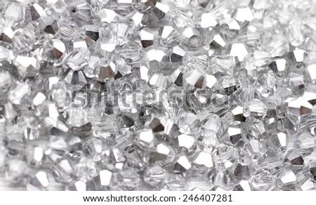 Beautiful glass beads closeup on white background - stock photo
