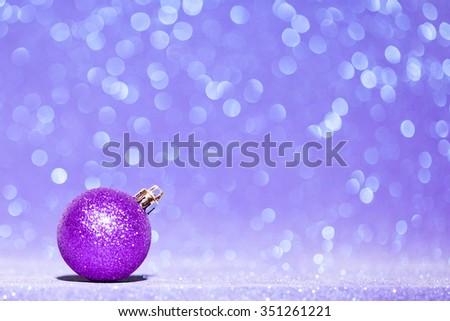 Beautiful Glitter christmas ball close-up on shining background - stock photo