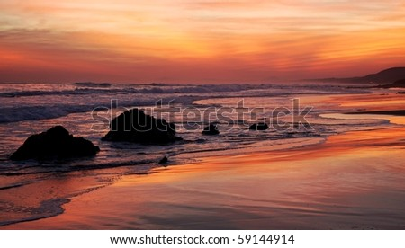 Beautiful glowing sunset on the South African coastline - stock photo
