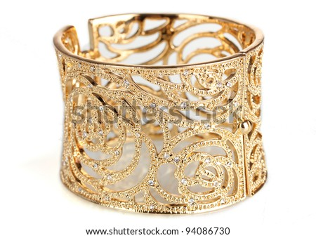 beautiful gold bracelet isolated on white - stock photo