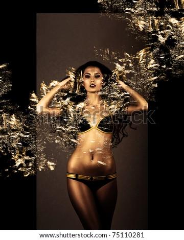 beautiful gold brunette woman in foliage - stock photo