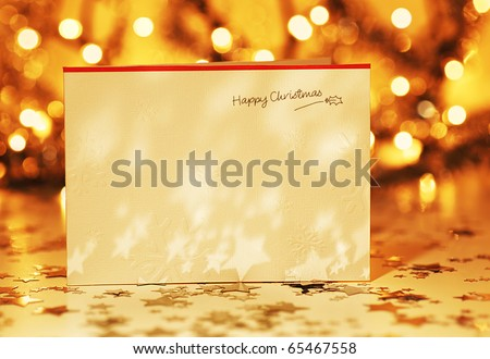 Beautiful gold happy Christmas card,winter holiday background, decoration postcard with stars over defocus lights - stock photo
