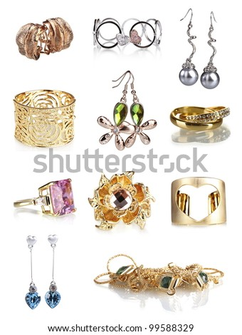 Beautiful gold jewellery collection isolated on white - stock photo