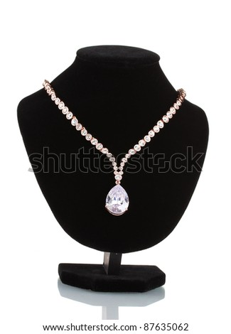 beautiful gold necklace with jewels stones on mannequin isolated on white - stock photo