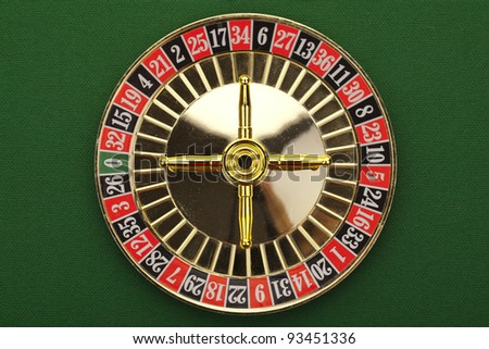 Beautiful gold roulette on a green background. - stock photo