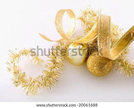 beautiful gold seasonal Christmas decorations on white background