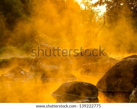 Beautiful gold steam hot spring at Jae Son National Park,Thailand - stock photo