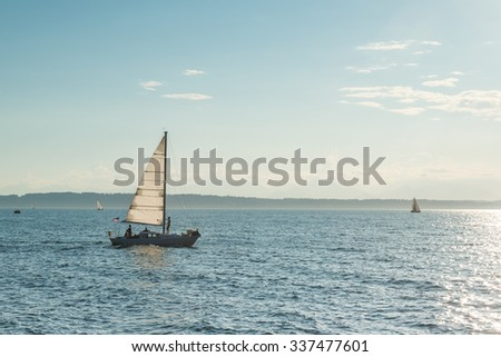 Beautiful gold sunset with a sailboat