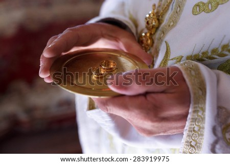 beautiful gold wedding jewelry rings bride and groom - stock photo