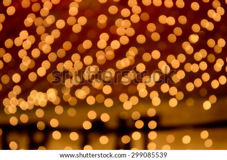 Beautiful golden background with defocused lighting. The light is captured as a defocused. - stock photo
