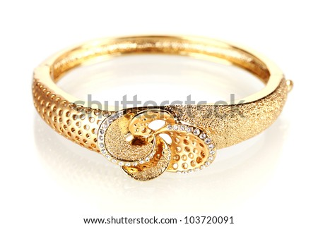 Beautiful golden bracelet with precious stones isolated on white - stock photo