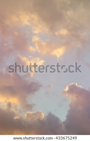 Beautiful golden cloudy evening sky background - stock photo