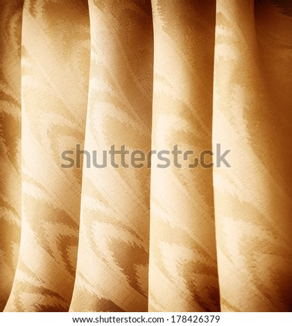 Beautiful golden curtains background, abstract backdrop, elegant rippled fabric with tender ornament, luxurious fashionable material  - stock photo