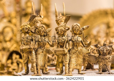 Beautiful golden dolls made of brass of miniature folk musicians performing in a band of classical Indian music - stock photo