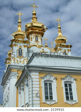 Beautiful golden domes of a church near St. Petersburg. - stock photo