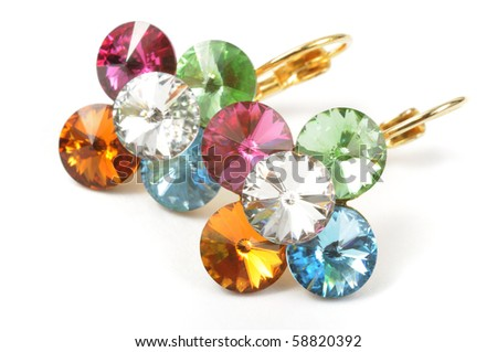 Beautiful golden earrings with colorful stones - stock photo