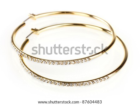 beautiful golden earrings with diamond isolated on white - stock photo