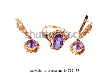Beautiful golden jewellery ring and earring  isolated on white background - stock photo