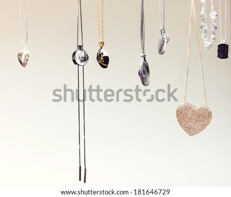 Beautiful golden necklaces with precious gems - diamonds - stock photo