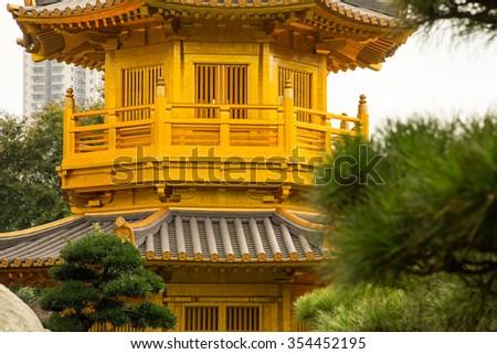 Beautiful Golden Pagoda Chinese style architecture in Nan Lian Garden, Hong Kong - stock photo