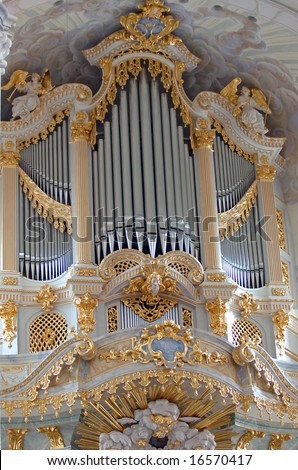 Beautiful golden pipe organ in a church in germany