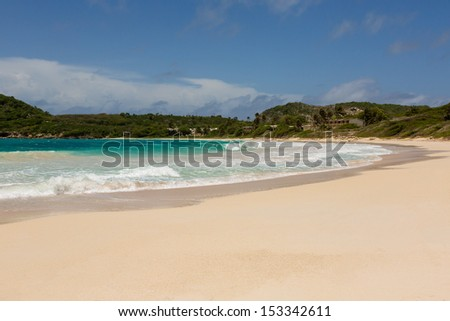 Beautiful Golden Sandy Beach at Half Moon Bay Antigua in the Sunshine - stock photo