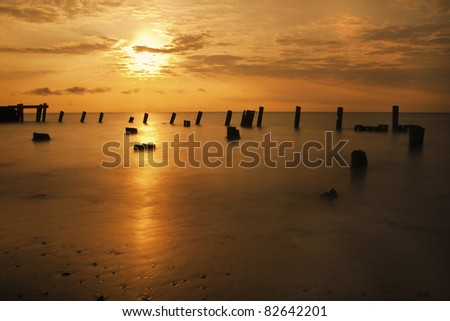 Beautiful golden sunrise on the Delaware Bay. - stock photo