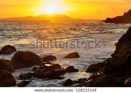 Beautiful golden sunrise over the Puerto Rican island of Culebrita - stock photo