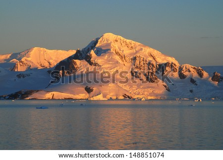 Beautiful golden sunset on snowy mountains