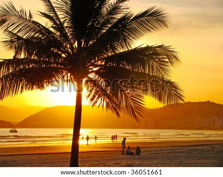 beautiful golden sunset on the beach of the city of santos in brazil - stock photo