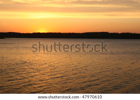 beautiful golden sunset over lake
