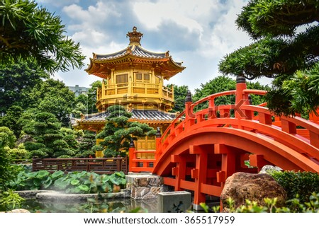 Beautiful golden teak wood pagoda at Nan Lian Garden in Hong Kong - stock photo