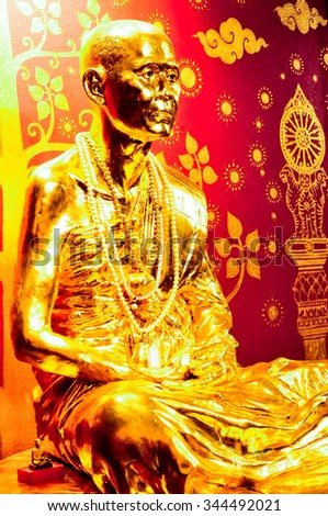 Beautiful golden The monk disciples of Buddha statue in Temple, Thailand. - stock photo