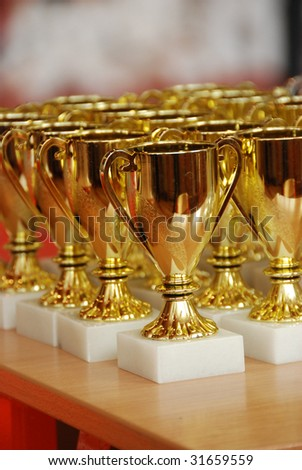 Beautiful golden trophy cups - stock photo