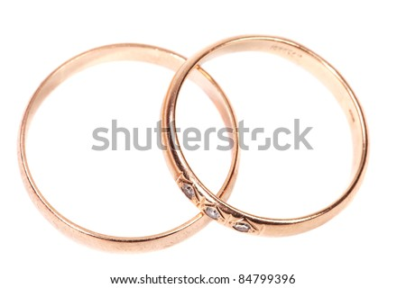 Beautiful golden wedding rings isolated on white background - stock photo