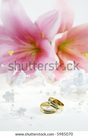 Beautiful golden wedding rings with flowers - stock photo