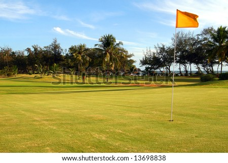 Beautiful Golf Course A gorgeous golf course at the ocean shore on a beautiful day. - stock photo