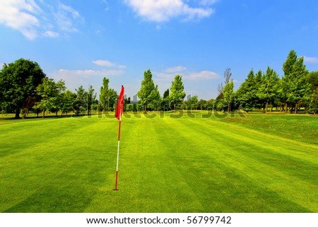 Beautiful golf course and blue sky - stock photo
