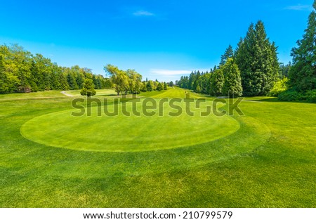 Beautiful golf course in a sunny day. Canada, Vancouver. - stock photo