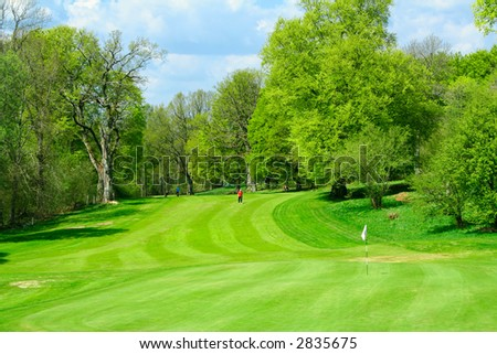 Beautiful golf course in fresh green colors of spring - stock photo