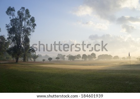Beautiful golf course in the morning - stock photo