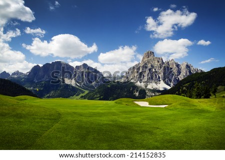 Beautiful golf course in the mountains with spectacular views - stock photo