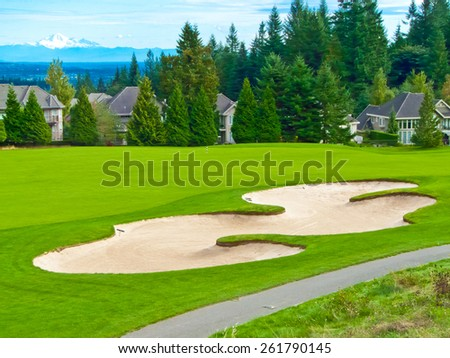Beautiful golf course with sand bunker. - stock photo