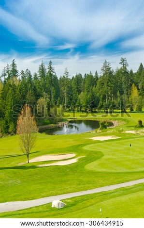 Beautiful golf course with sand bunkers. Vancouver, Canada. Vertical.