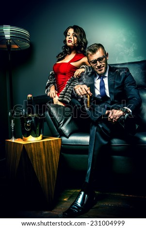 Beautiful gorgeous couple in elegant evening dresses in a classic interior. Fashion, glamour. - stock photo