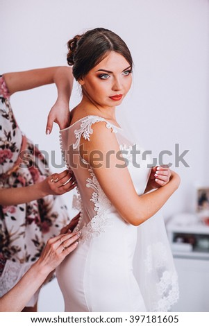 beautiful gorgeous stylish bride brunete getting ready in the morning in the room - stock photo