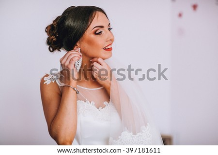beautiful gorgeous stylish bride brunete getting ready in the morning in the room