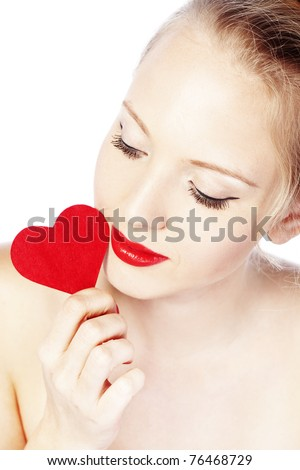 Beautiful gorgeous woman with glamour bright makeup and red heart - stock photo