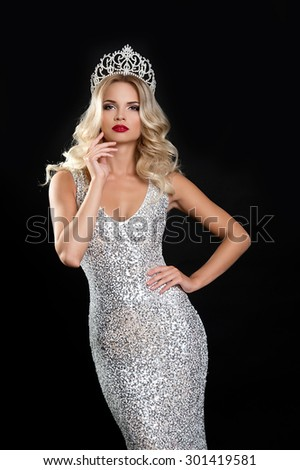Beautiful gorgeous young woman with luxurious hair with crown of beauty contest - stock photo